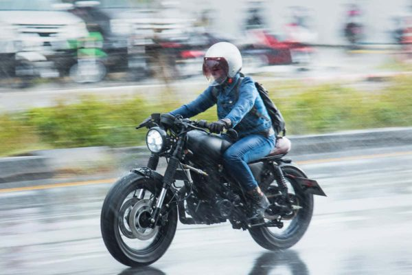 Wax Jacket in the rain on a motorcycle background image